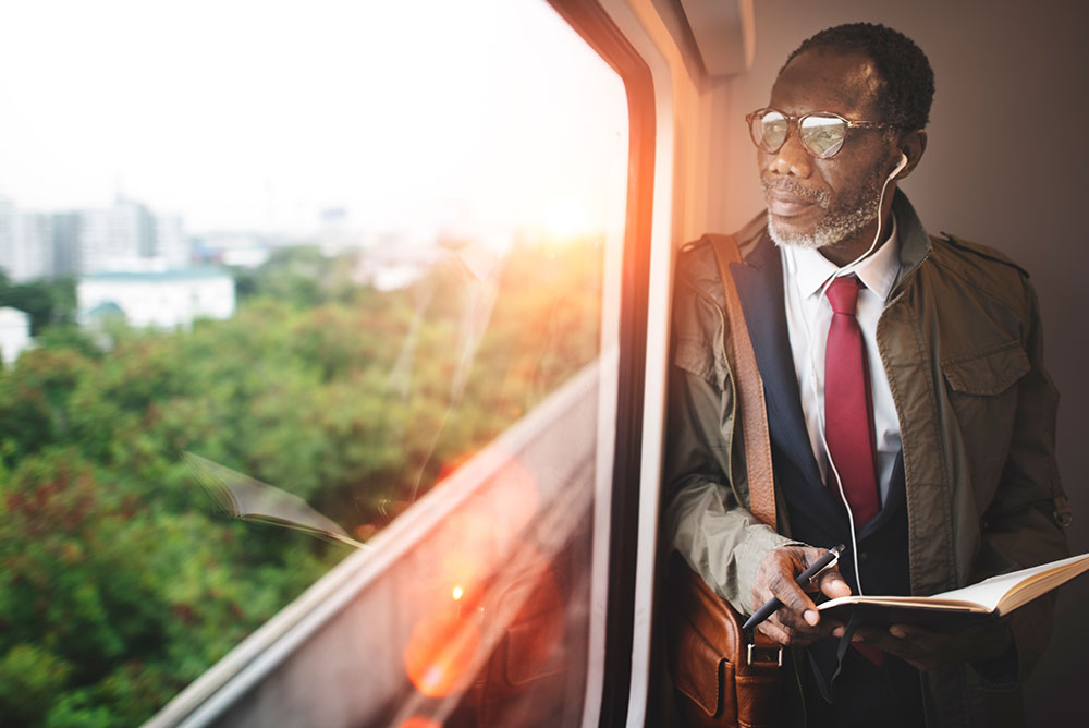Businessman on a train looking out the window